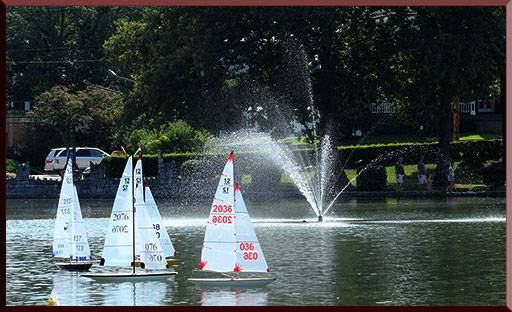 Model yachts being sprayed in a fountain